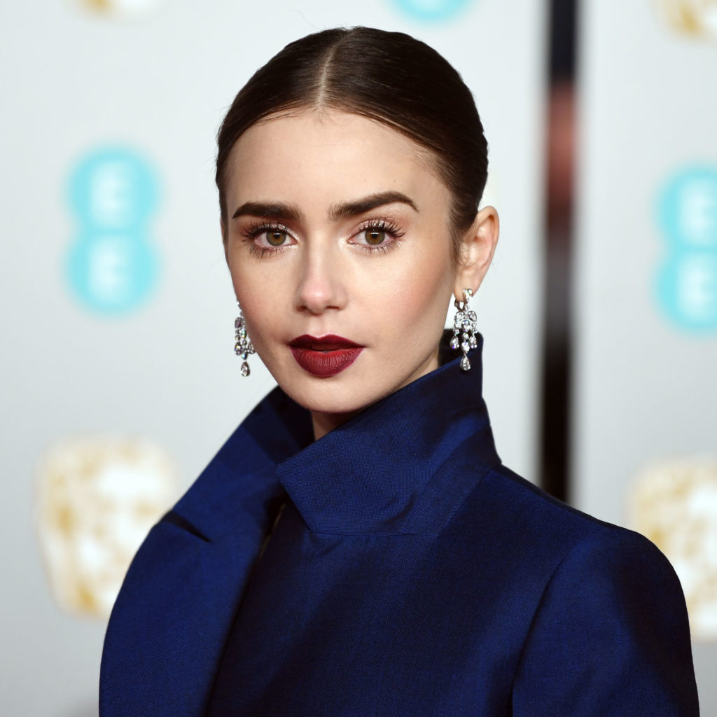 Mandatory Credit: Photo by NEIL HALL/EPA-EFE/REX/Shutterstock (10100907bo) Lily Collins attends the 72nd annual British Academy Film Awards at the Royal Albert Hall in London, Britain, 10 February 2019. The ceremony is hosted by the British Academy of Film and Television Arts (BAFTA). Arrivals - 2019 EE British Academy Film Awards, London, United Kingdom - 10 Feb 2019