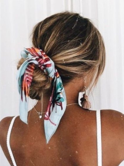patterned hair scarf in a low bun