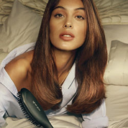 ghd glide model image on bed