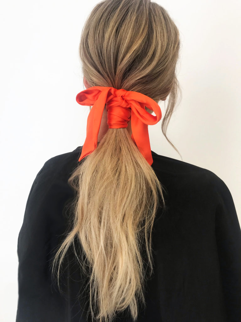 orange hair scarf bow tie ponytail