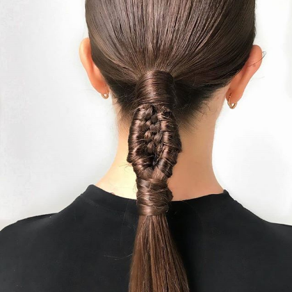 Part braided low ponytail