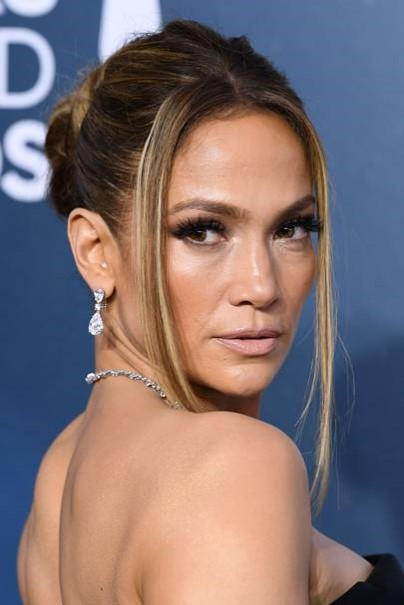 J.lo 90s tendril updo